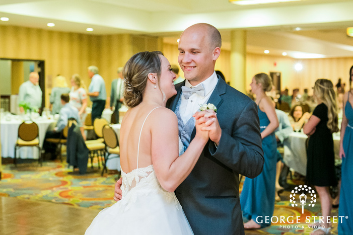 cheerful bride and groom first dance in reception party at minneapolis marriott northwest wedding photo
