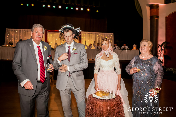 beautiful couple with parents at wedding ceremony