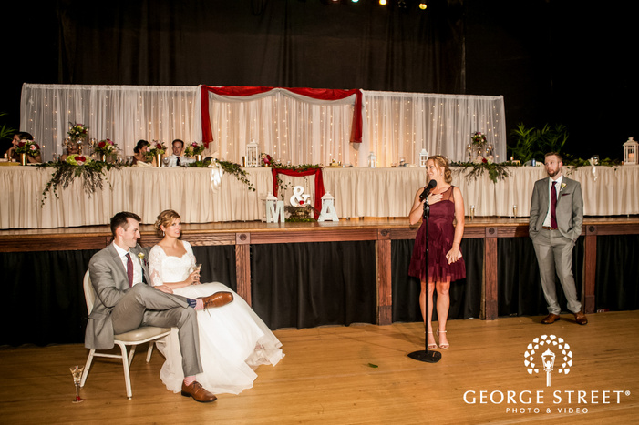 charming bride and groom at reception toast