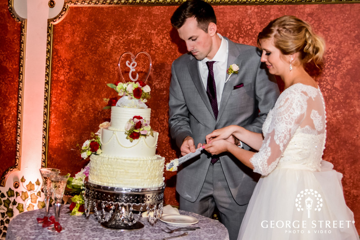 charming bride and groom cake cutting ceremony wedding photography