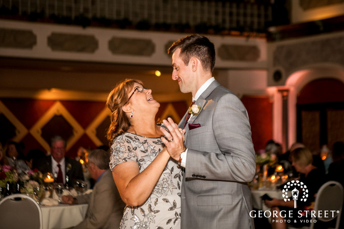 excited groom and mother at reception dance