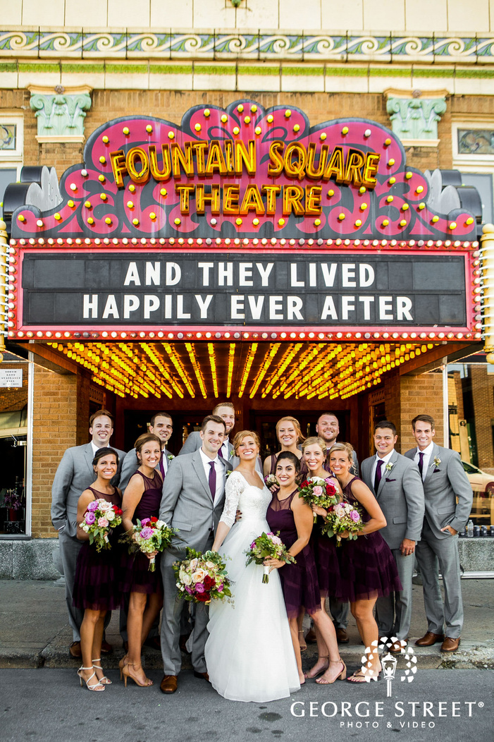 happy couple with bridesmaids and groomsmen at fountain square theatre in indianapolis
