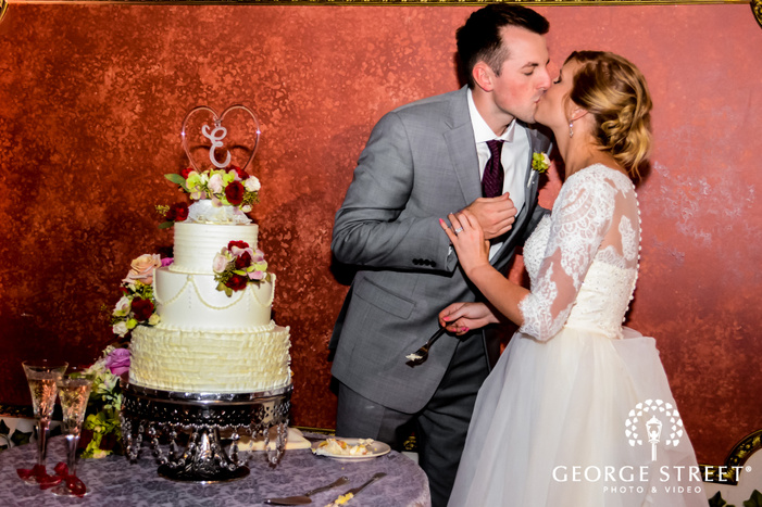romantic bride and groom cake cutting ceremony wedding photo