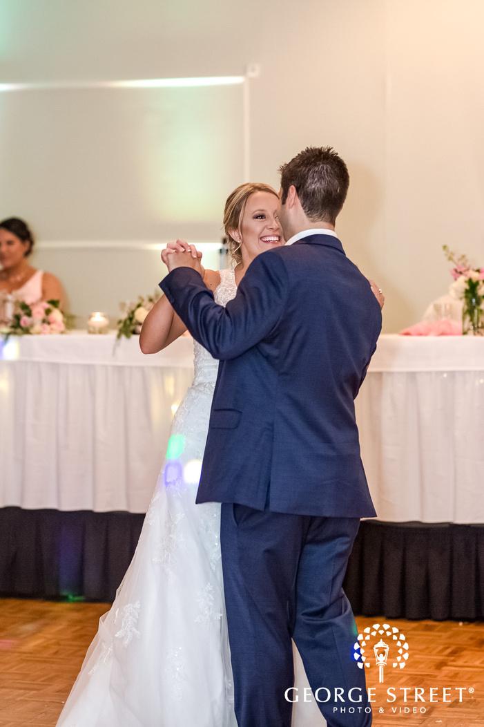 cute bride and groom on dance floor wedding photography