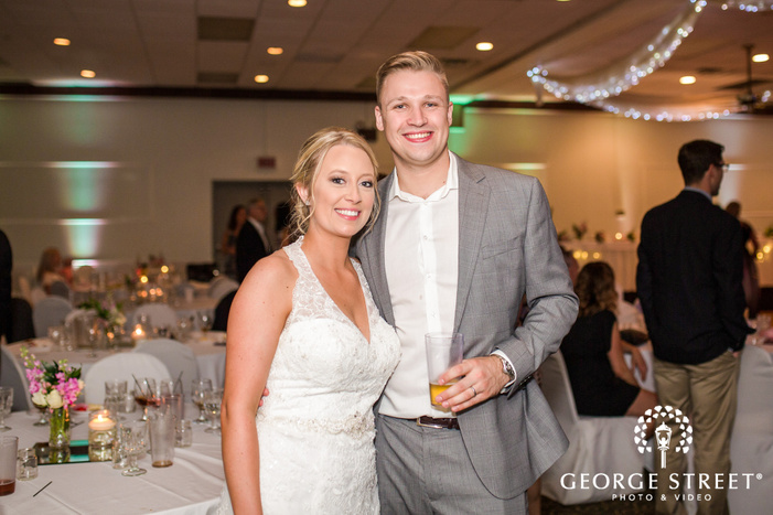 cute bride and guest in hall wedding photo