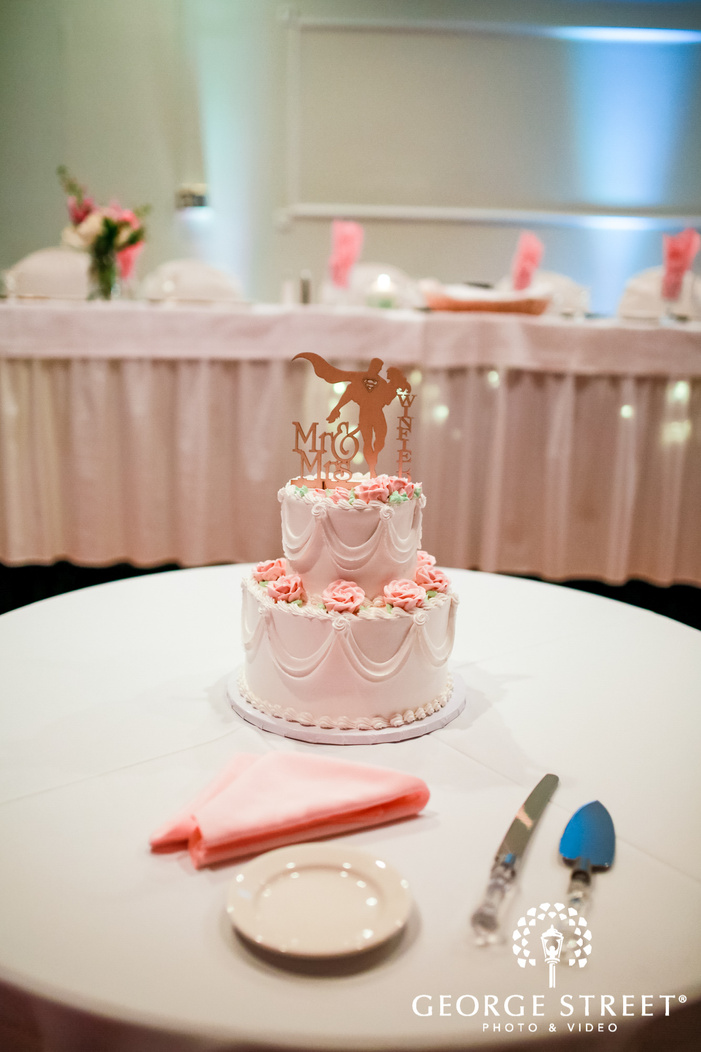 elegant two tier cake with topper wedding photo