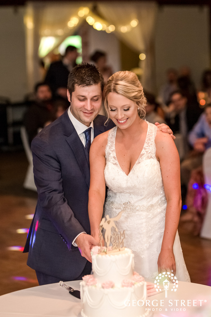 happy bride and groom cake cutting ceremony at harmar house in pittsburgh wedding photography