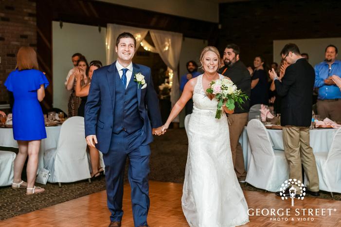 happy bride and groom reception entrance wedding photography