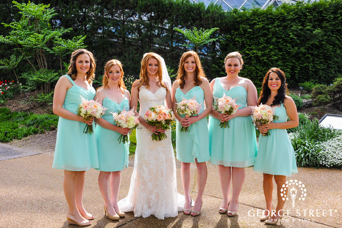 bride and bridesmaid in teal