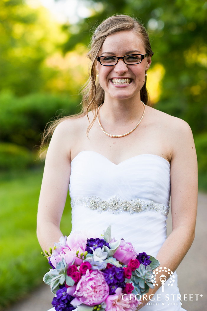 bride with purple and pink bouquet