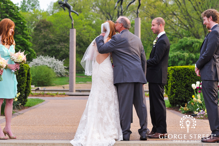 father and daughter at wedding aisle