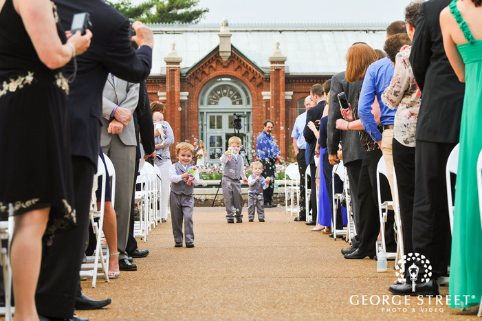 ring bearers carrying bubbles