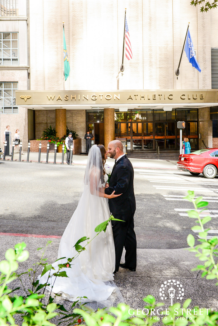 adorable bride and groom in front of washington athletic club in seattle