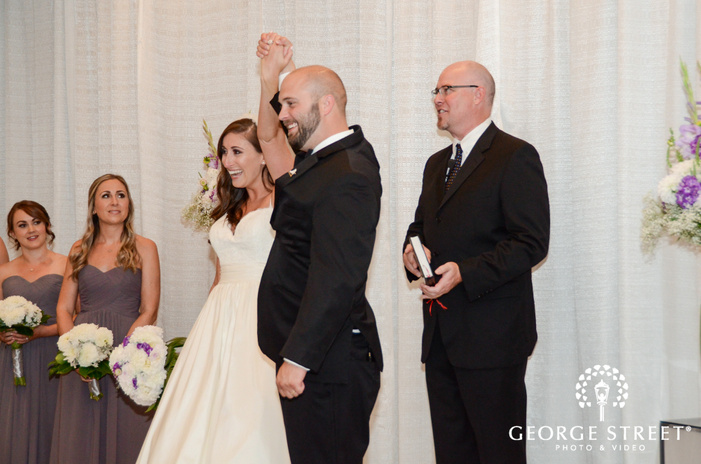 cheerful bride and groom ceremony exit wedding photography