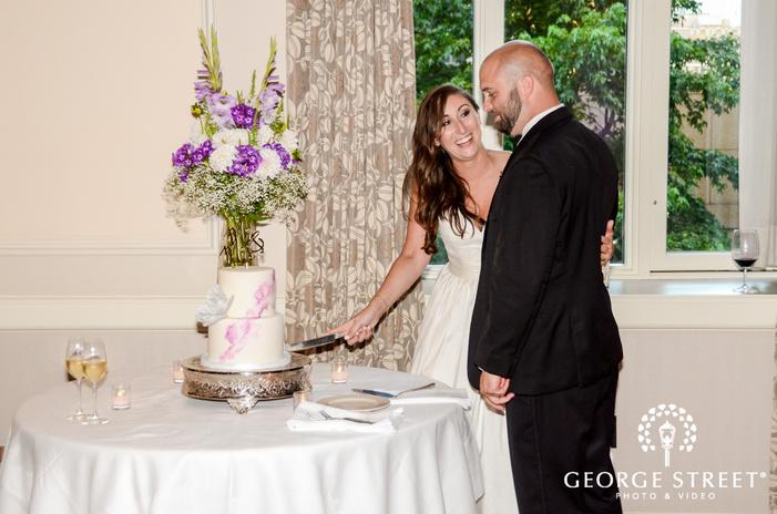 cheery bride and groom cake cutting ceremony wedding photo
