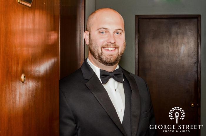 handsome groom in room wedding photo