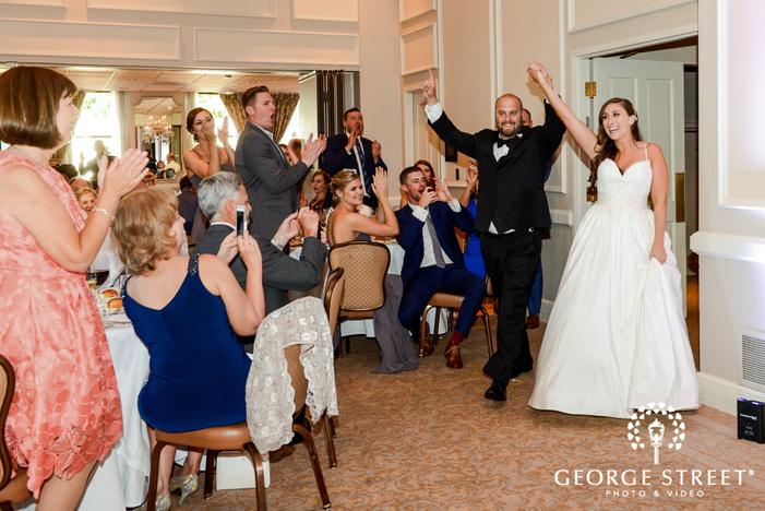 joyful bride and groom reception entrance at washington athletic club in seattle