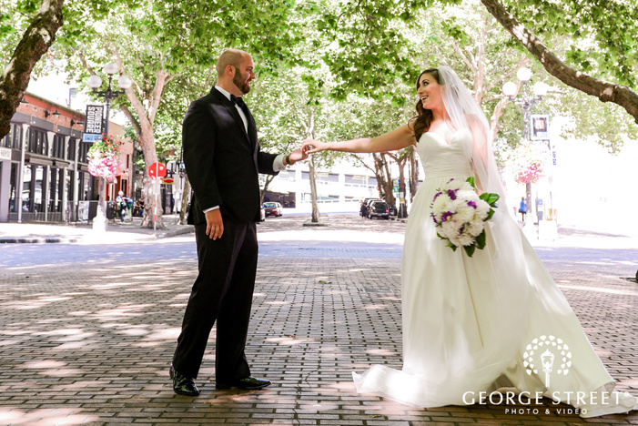 joyous bride and groom on pathway in seattle wedding photography