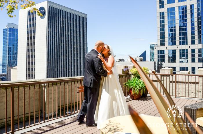 loving bride and groom on roof wedding photo