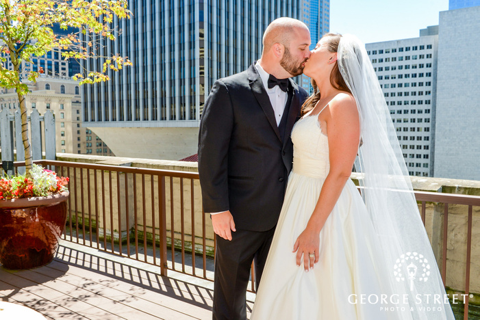 passionate bride and groom on rooftop wedding photography