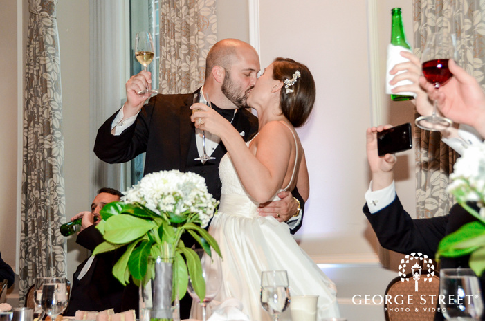 passionate bride and groom wedding photo