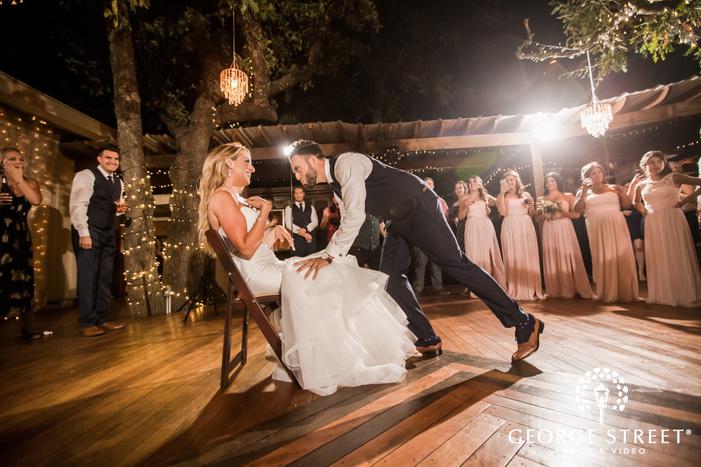 joyful bride and groom playing reception game wedding photos