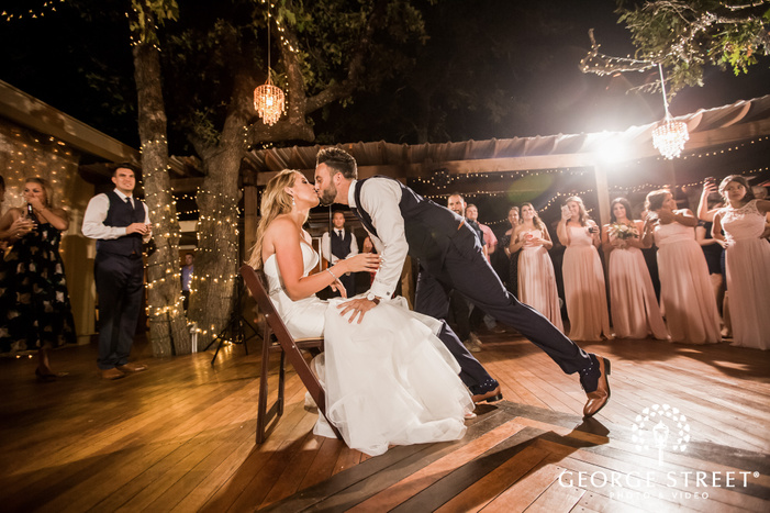 romantic bride and groom on reception game at kindred oaks in austin