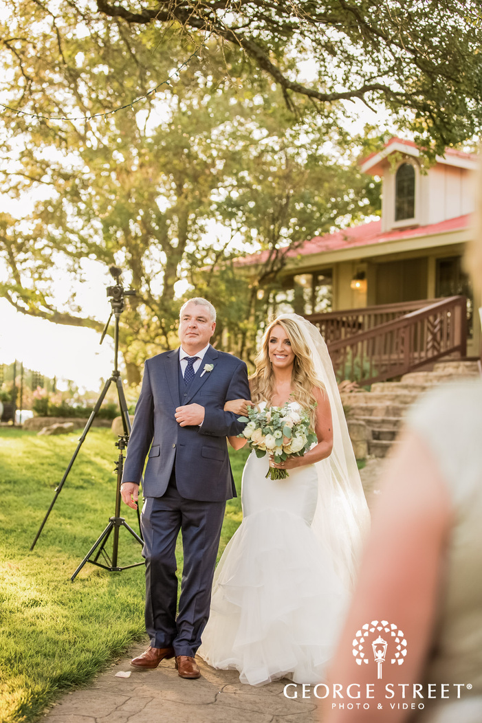 sweet bride and father at wedding ceremony entrance