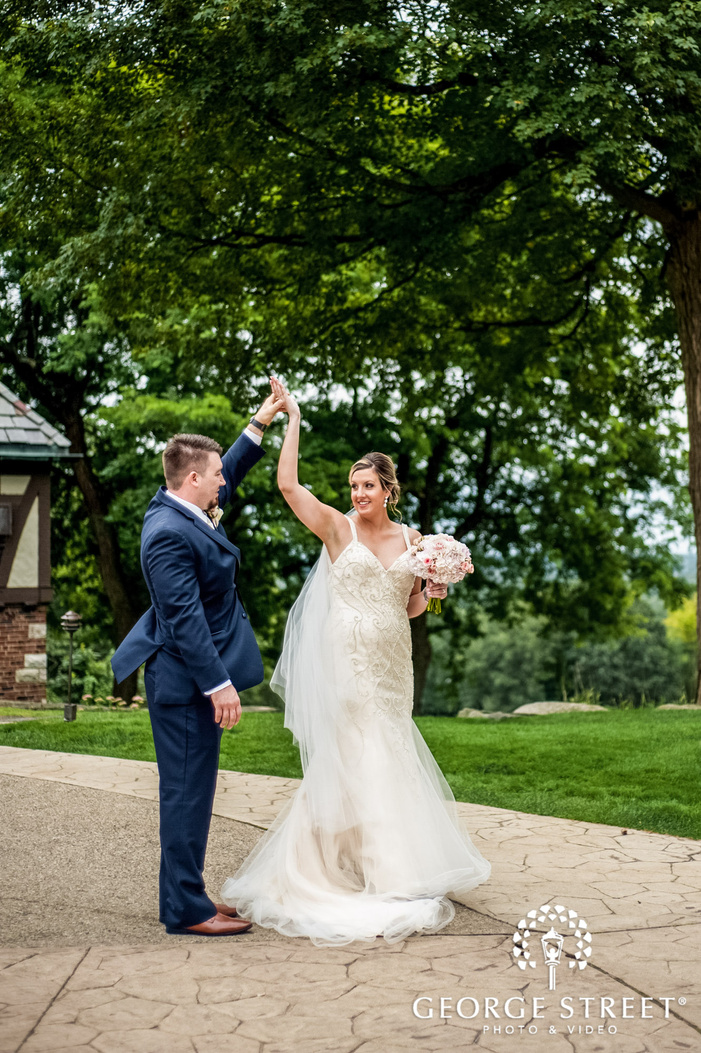 cheerful bride and groom on walkway in detroit wedding photography
