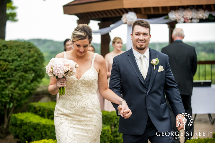 excited new wed couple exit from ceremony wedding photo