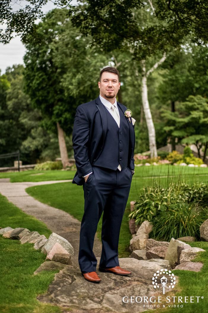 happy groom in green garden at pine knob mansion in detroit wedding photography