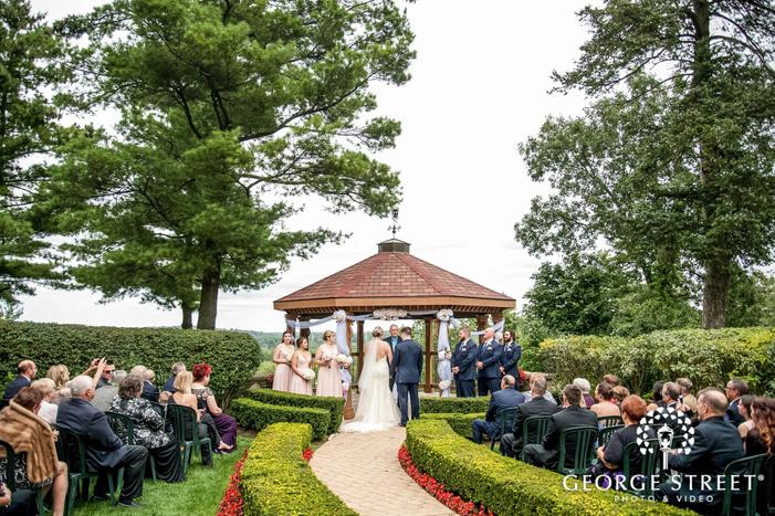 happy wedding ceremony in gazebo outside pine knob mansion in detroit wedding photos