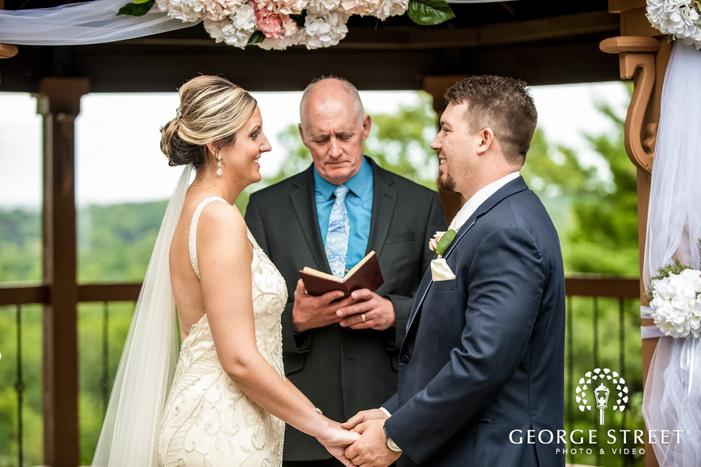 loving bride and groom vows exchange at wedding ceremony wedding photos