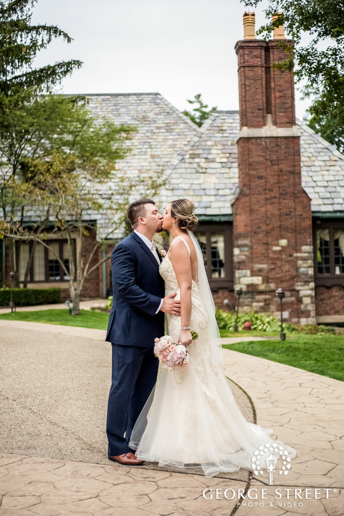 romantic bride and groom on walkway to pine knob mansion in detroit wedding photography