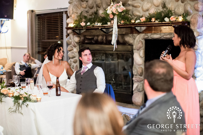 good looking bride and groom during reception toast