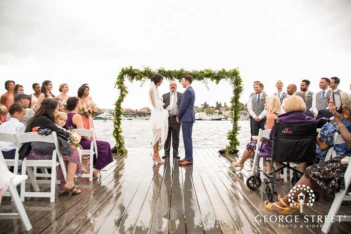 gorgeous bride and groom wedding ceremony at lake union crew in seattle