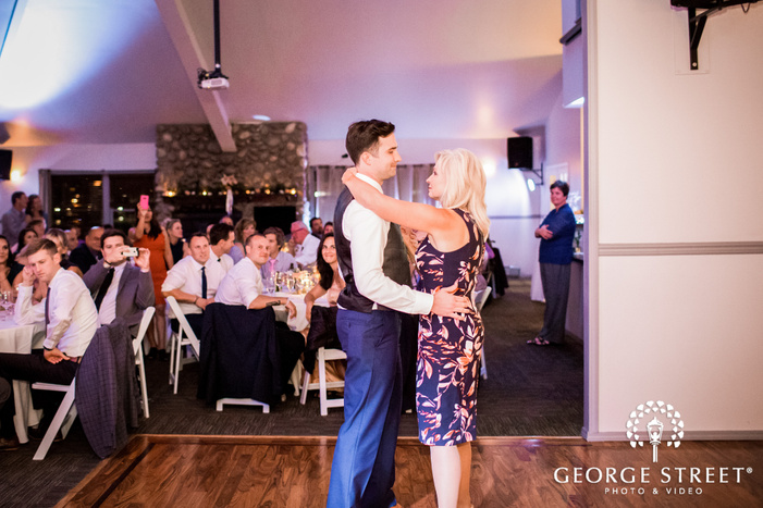 handsome groom and mother reception dance