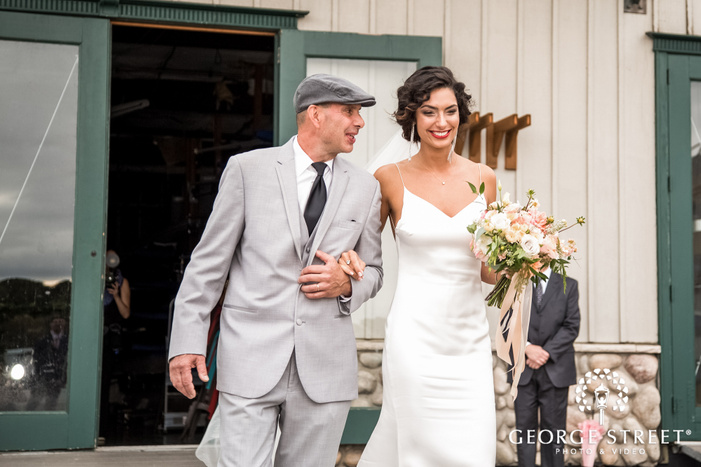 joyful bride and father at ceremony entrance