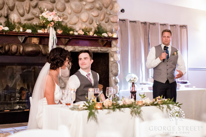 mesmerizing bride and groom during reception toast