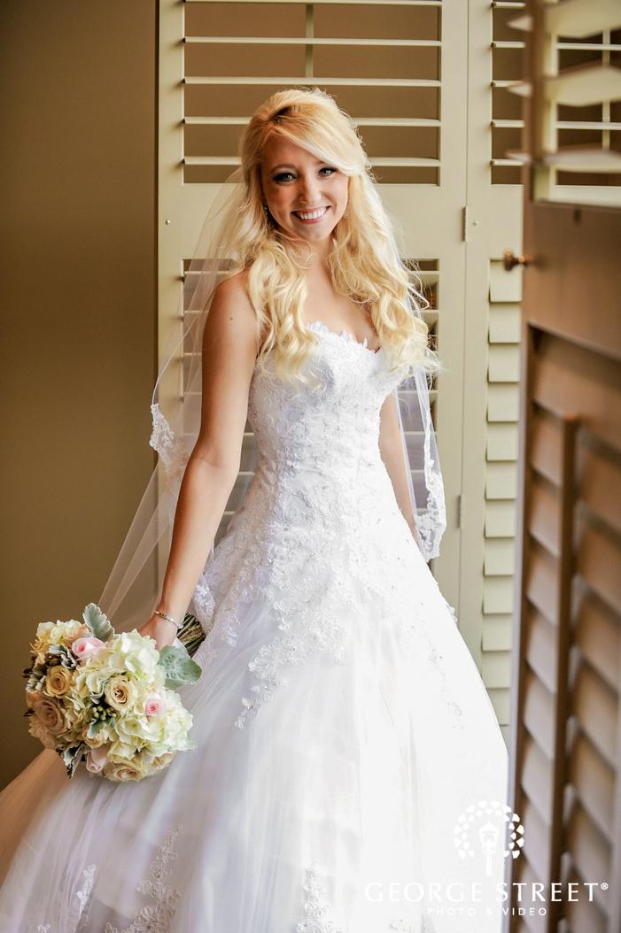 cherry creek golf club cheery bride infront of window detroit wedding photos