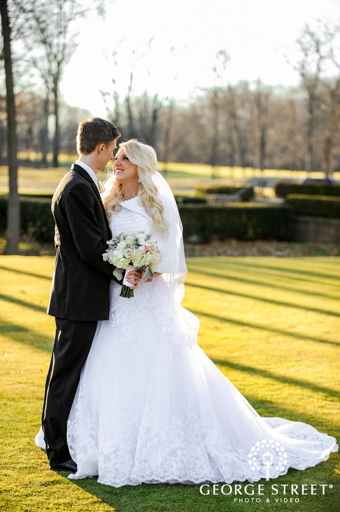 creek golf club cheery couple in grassyland detroit wedding photos