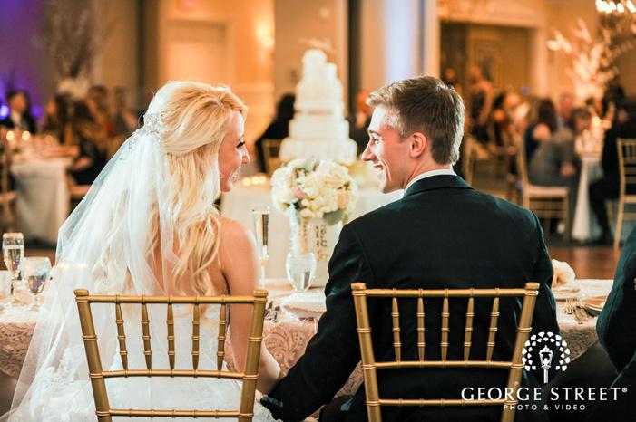 creek golf club joyful couple on reception table detroit wedding photos