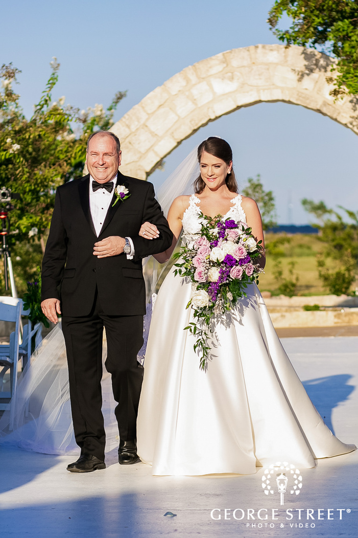 blissful bride and father marching down the aisle in dallas fort worth wedding photos