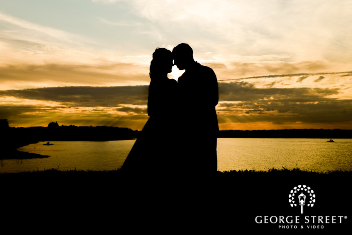 loving bride and groom near lake at paradise cove in dallas fort worth wedding photography