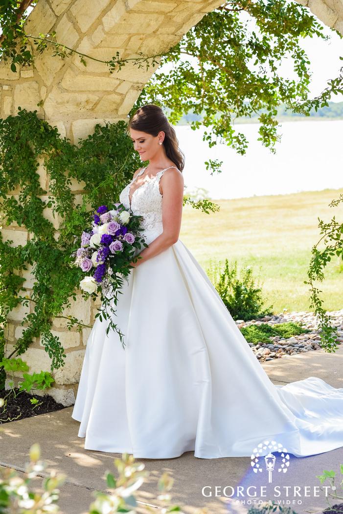 pretty bride under walkway arch wedding photography