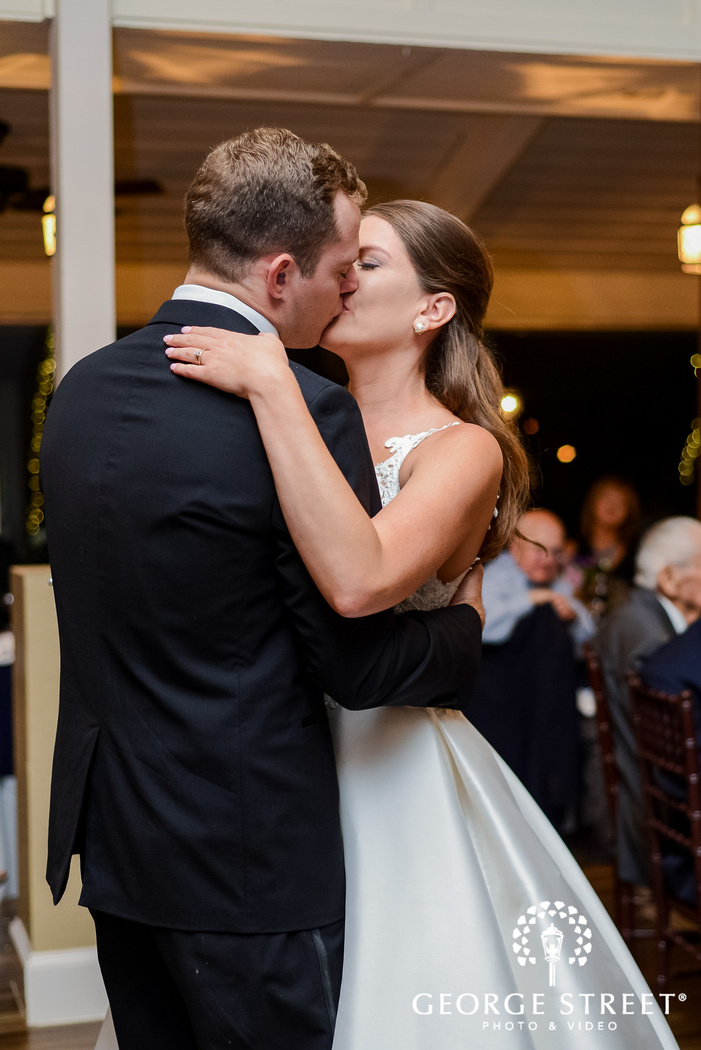romantic bride and groom first dance in reception wedding photos