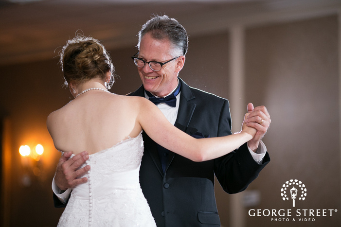 candid father and bride dance