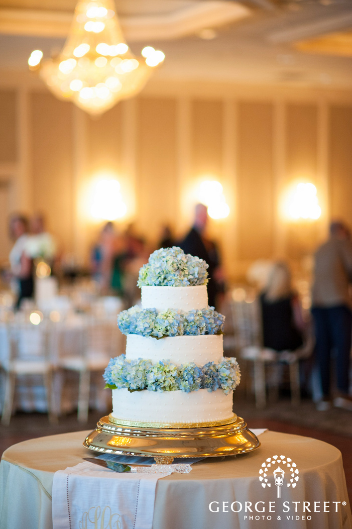 custom blue and white floral wedding cake