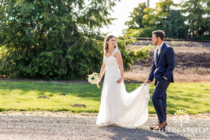 charming bride and groom on walkway