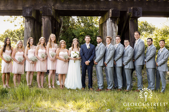 cute couple with bridesmaids and groomsmen wedding photo